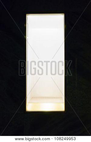 display window against black, empty