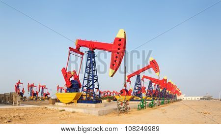 view of oilfield with many pump units