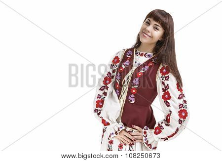 Traditions Concept. Caucasian Brunette Woman In Flowery Hand-made Unique Dress. Isolated Over White