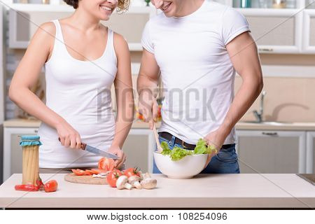 Nice couple cooking in the kitchen