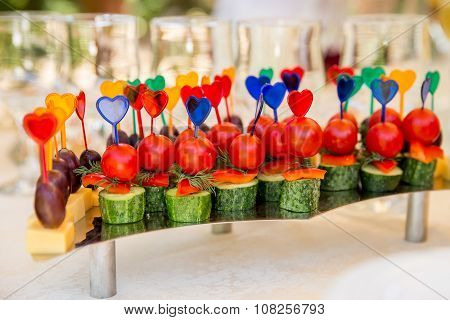 Canape with tomatoes and cucumbers for party