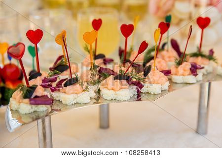 Canape with red fish with white bread