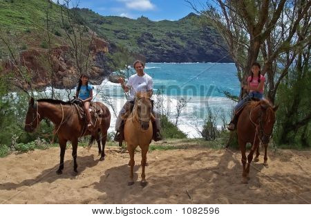 Daughters And Dad On Horseback By A Cove
