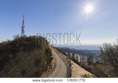LOS ANGELES, CALIFORNIA, USA - November 24, 2013:  Hollywood Sign and Griffith Park mountaintop overlooking Los Angeles.