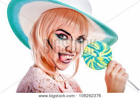 Girl With Makeup In The Style Of Pop Art, Hat And Lollipop.