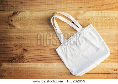 White Cotton Bag Place On A Wooden