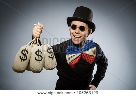 Funny man with money dollar sacks