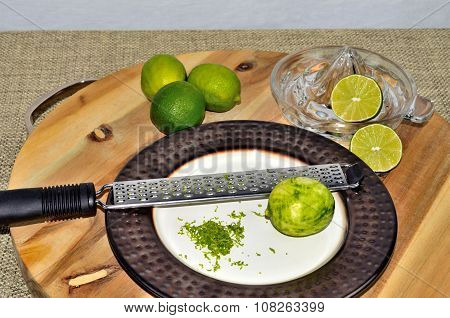 Limes with zest, zester and juicer