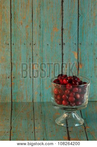 Bowl Of Cranberries On A Wooden Turquoise Background