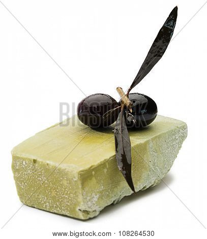 Olive's branch on natural olive oil soap isolated on white background.