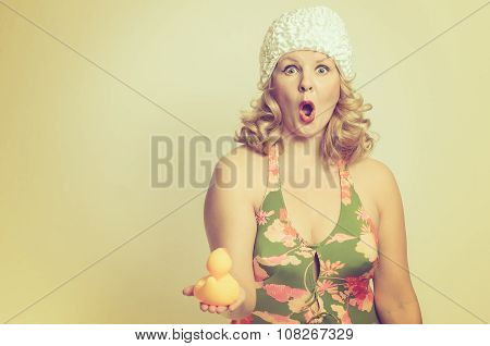 Shocked Young Woman Holding A Duck