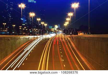 Night highway with moving traffic lights on it