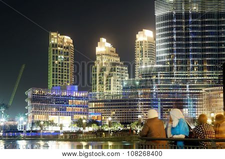 Modern skyscrapers and arab islamic people