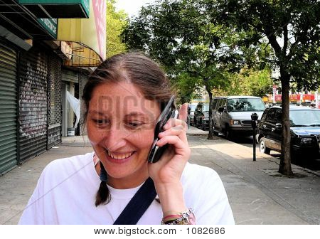 Woman On Street Talking On Cell Phone Sidekick Pda