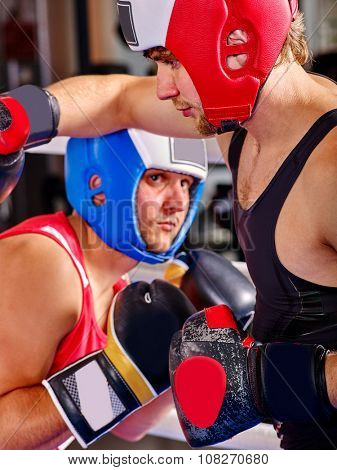 Sport men boxer wearing colored helmet and  gloves boxing .