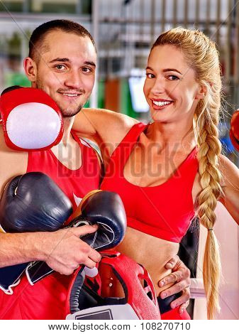 Couple Man and  Woman in red Wearing Gloves Boxing in Ring.