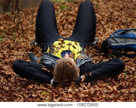 mountaineer resting on dry leaves