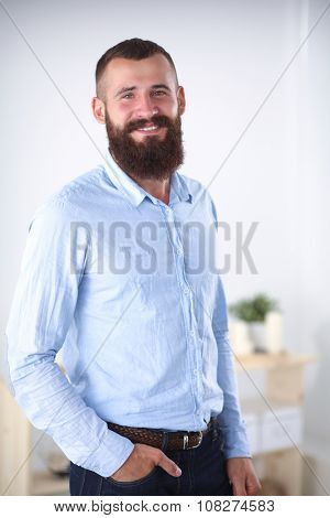 Portrait of a business man standing in office, isolated on whitebackground