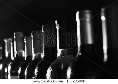 Chilled wine bottles in a row,  black and white retro stylization