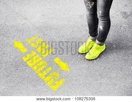 Female feet on road background