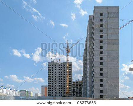 Tower Crane On The Construction Of A New Multi-storey House. Side View