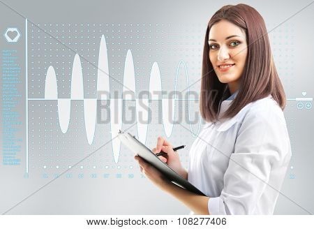 Young beautiful doctor with clipboard and cardiogram