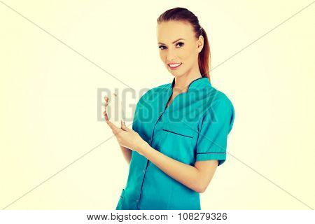 Beautiful doctor woman with a bandage.