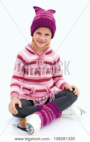Ice Skating. The Little Girl Sitting On Ice In Ice Skating. Isolated On White Background.