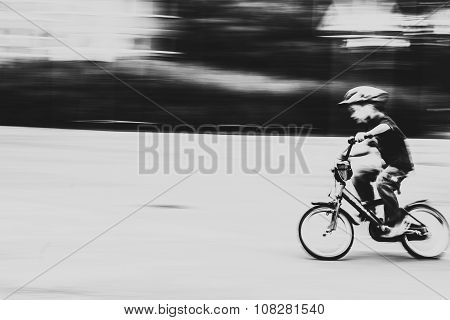 Boy riding a bicycle at high speed. Shot on a long exposure.
