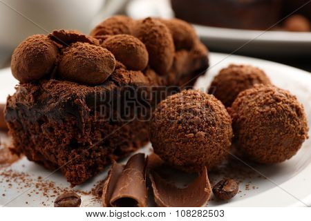 A piece of chocolate cake balls on the table, close-up