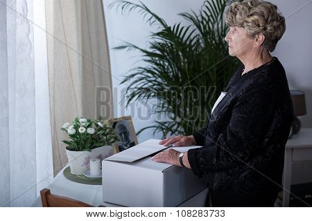 Sad Widow Holding Box