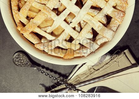 Homemade apple pie on wooden background