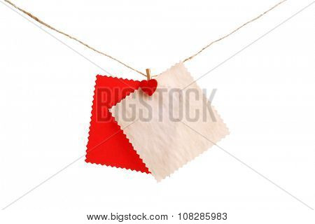 Empty sheets hang on cord isolated on white background