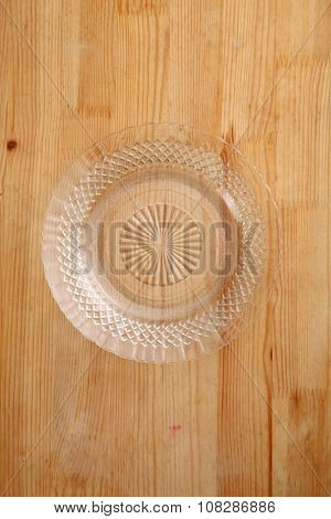 top view of glass plate or saucer on the wooden background