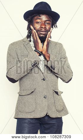 young handsome afro american man gesturing emotional posing isolated on white background