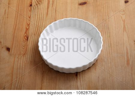 crostata mould on the wooden background