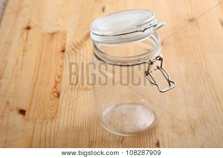 opened air tight glass jar on the wooden background