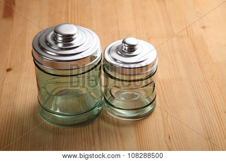 air tight glass jar on the wooden background