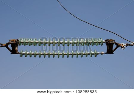 High-voltage Transmission Insulators Against The Blue Sky