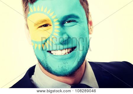Happy man with Kazakhstan flag painted on face.