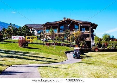 Pirin Golf Club house and restaurant, trees, golf cart, blue sky