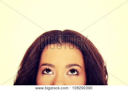 African woman's eyes looking up.