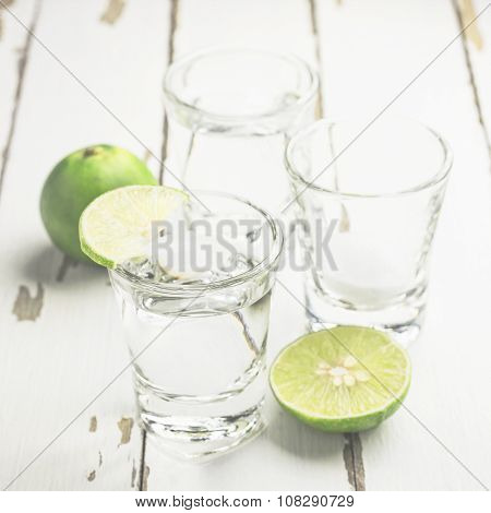 Vodka Shot With Lime And Salt On Wooden Table Background, Soft Focused