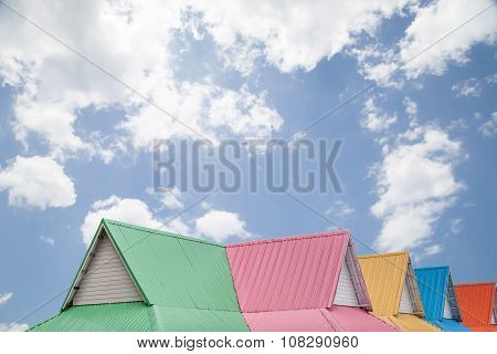 Multicolor roof on blue sky and cloud background