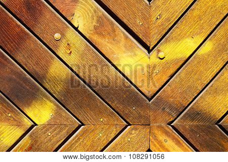 Surface Of An Old Wooden Planks Arranged V-shape