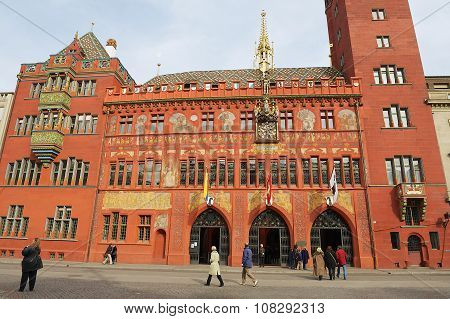 People walk in front of the Town Hall buylding in Basel, Switzerland.