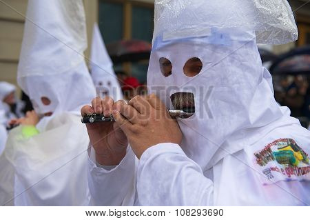 Men play flutes at Basel Carnival in Basel, Switzerland.