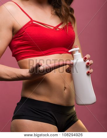 Sporty Woman With Body Lotion