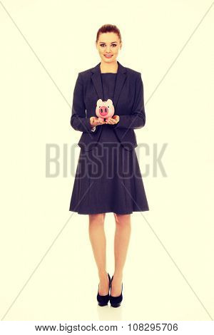 Happy business woman with piggybank.