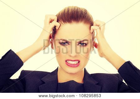 Frustrated and angry business woman screaming loud.